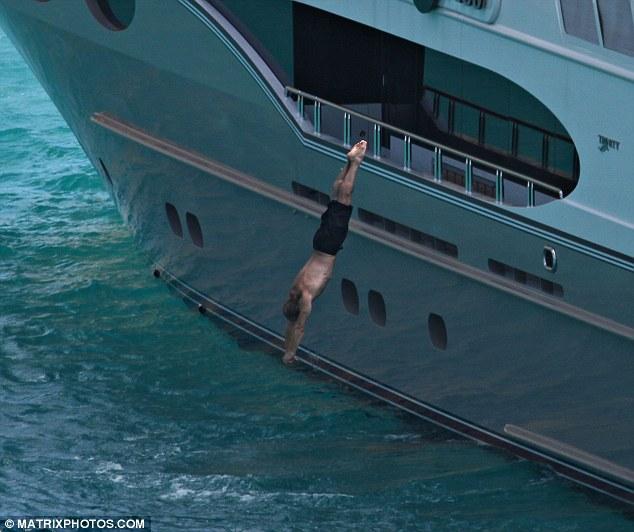jason statham does breathtaking dive on luxury yacht