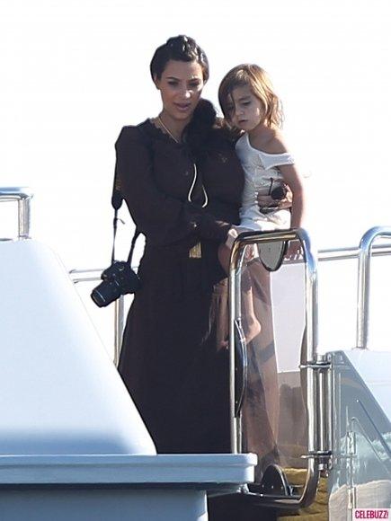 kim kardashian holiding kourtney kardashian's son mason on luxury yacht O'Ceanos in greece