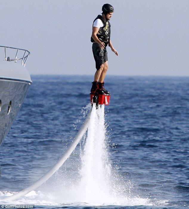 leonardo dicaprio flyboarding on luxury yacht vacation in ibiza