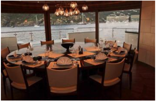 dining room with great views from large windows on board Steven Spielberg's luxury yacht Seven Seas