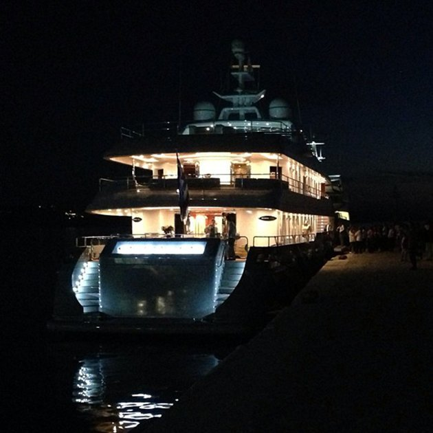 the kardashian family's chartered luxury yacht O'Ceanos lit up at night