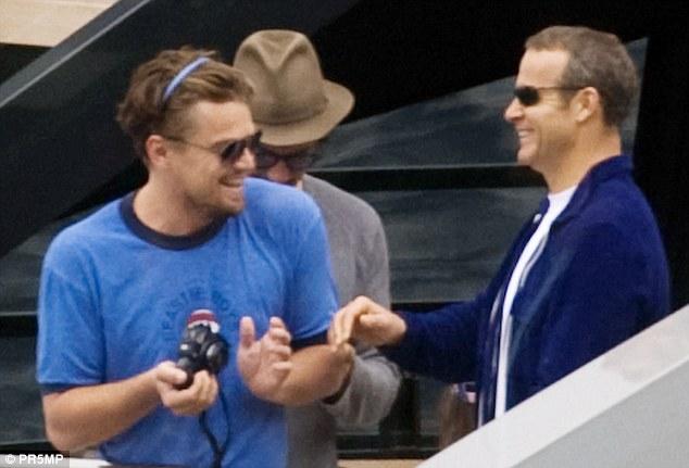 Vladimir Doronin and Leonardo DiCaprio on superyacht Ocean Emerald in capri