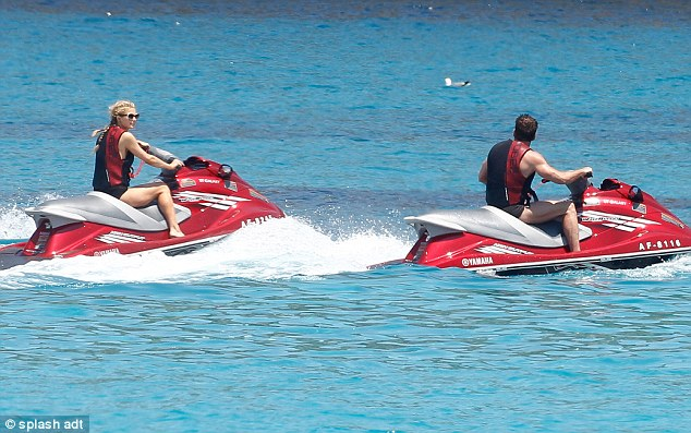 Paris and Thomas on jetskis off the coast of Spain
