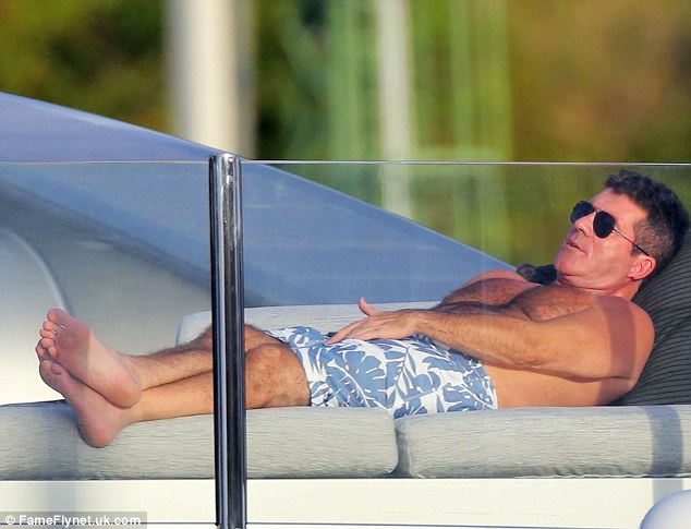 Simon Cowell on deck on superyacht Slipstream