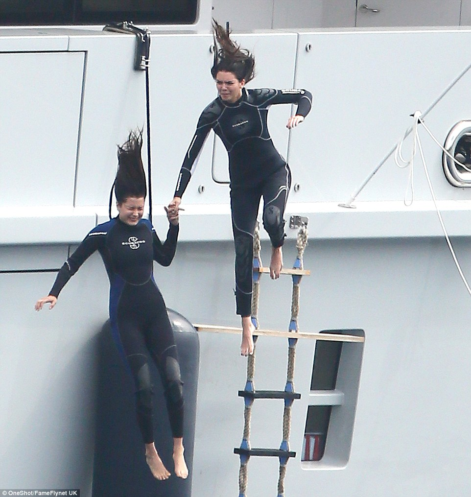 kendall jenner and bella hadid dive off superyacht axioma into water