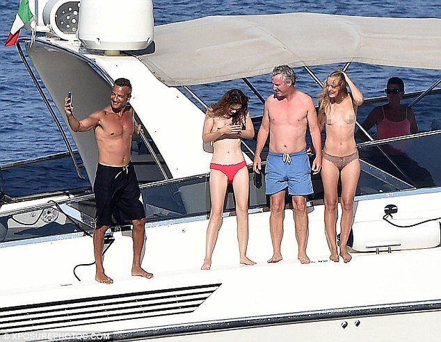 eddie irvine on deck of superyacht diversion with topless women and friend