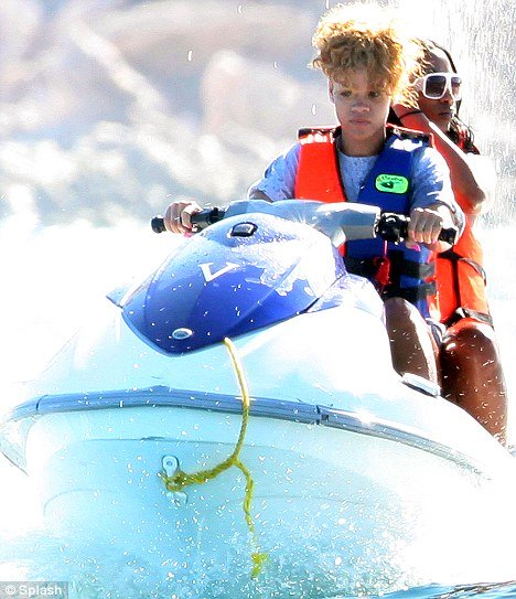 rihanna on jetski on charter vacation in mexico