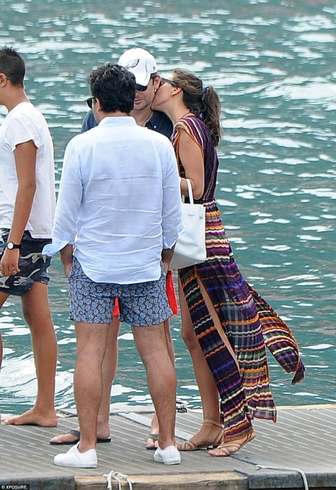 irina shayk kisses bradley cooper at harbour in italy