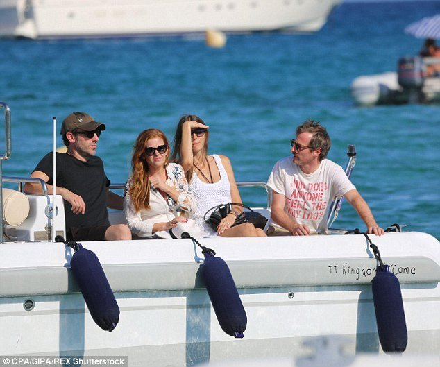 comic sacha baron cohen and actress isla fisher travel by tender to bono's luxury yacht 'kingdom come'