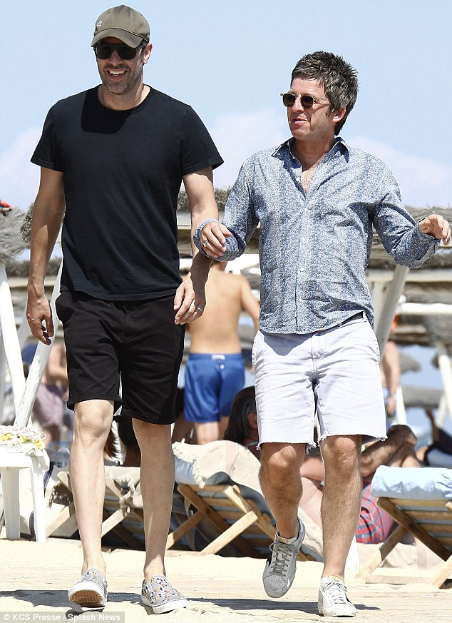 sacha baron cohen and noel gallagher on st tropez beach on yacht vacation on bono's yacht 'kingdom come'