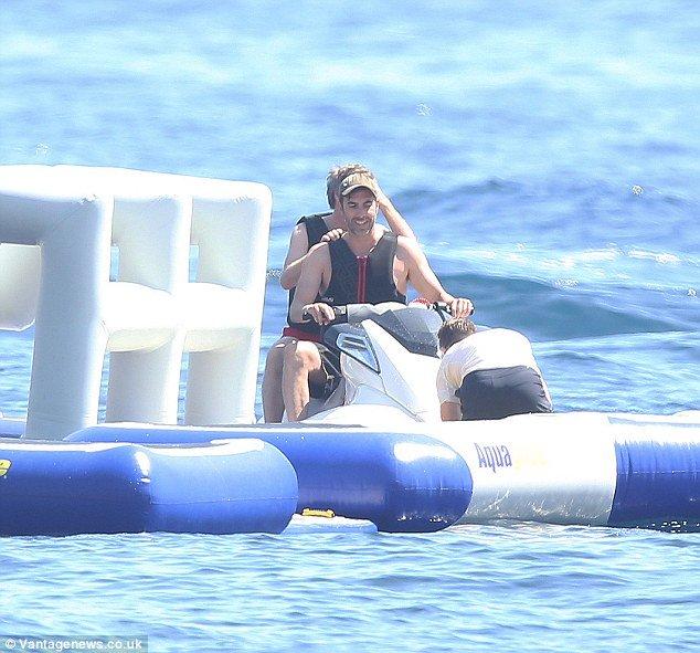 sacha baron cohen on jet-ski on superyacht 'kingdom come' (owned by U2 singer Bono)