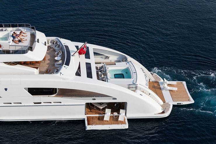 aft view of heesen motor yacht galactica star's (rented by Jay Z and Beyonce) Beach Club and fold-out balconies